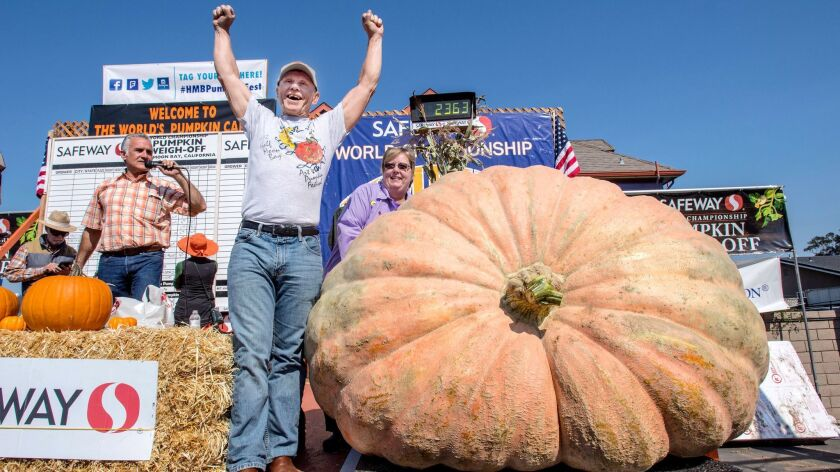 Joel Holland throws his arms into the air Oct. 9 after winning the 44th World Championship Pumpkin Weigh-Off in Half Moon Bay, Calif.