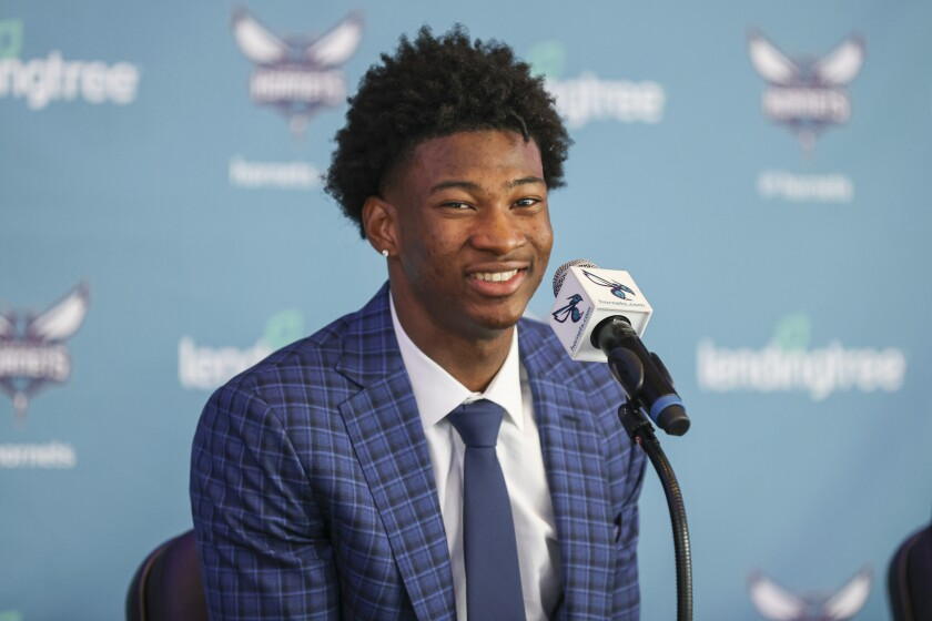 Charlotte Hornets 2021 NBA draft pick Kai Jones answers a question at a news conference in Charlotte, N.C., Friday, July 30, 2021. (AP Photo/Nell Redmond)