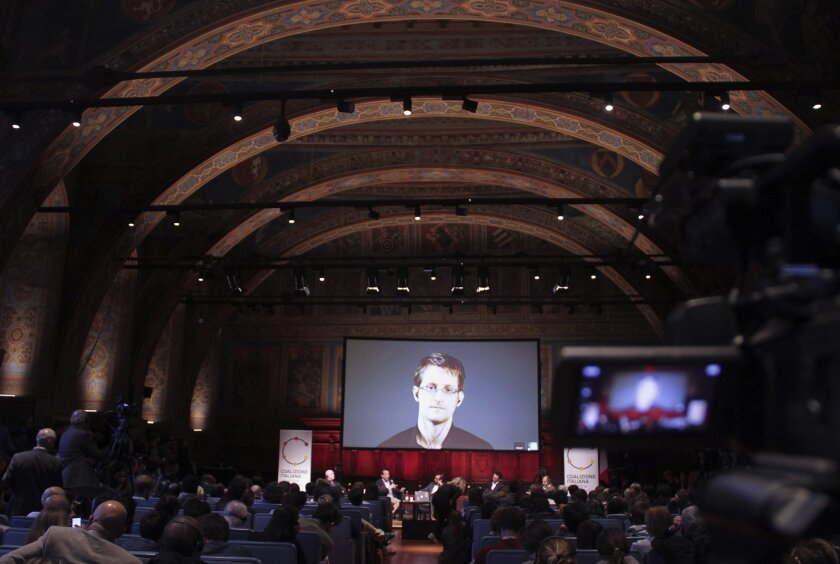 National Security Agency leaker Edward Snowden appears on a live video during the International Journalism Festival in Perugia, Italy, on April 17.