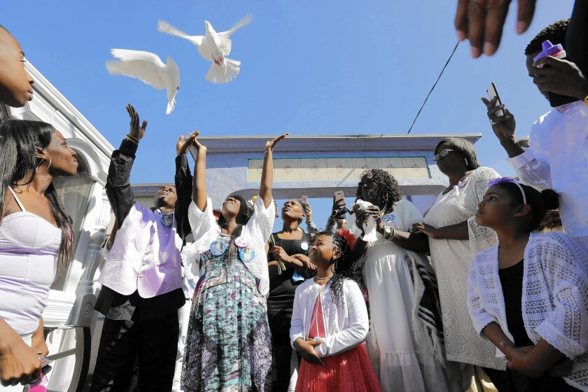 Darrell Johnson and Blanche Wandick, Autumn Johnson's parents, release doves in their daughter's memory at Angeles Abbey Memorial Park.