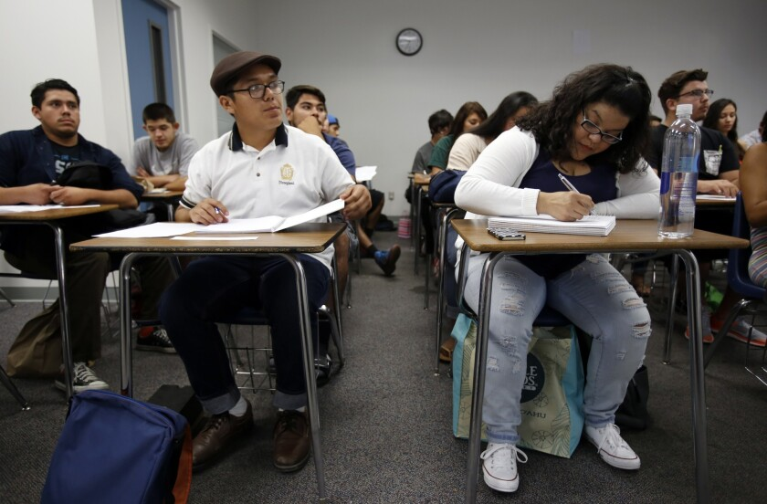 Apolo Ayala, 18, left, and Tiffany Guerra, 32, take notes during a class at Rio Hondo College in Whittier, as part of the new Pathways to Law School initiative that aims to connect more California community college students to law schools in the state.