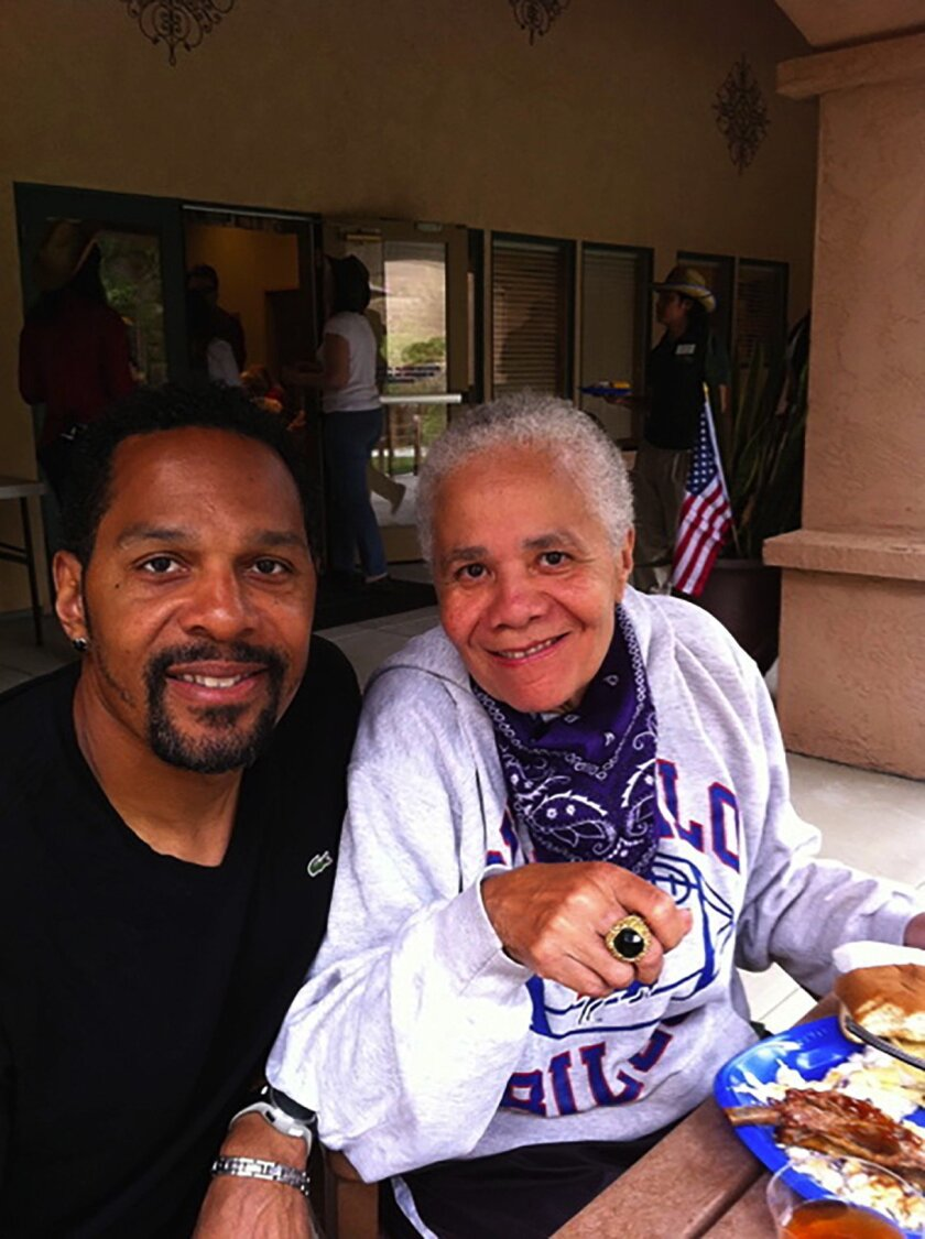 Quinn Early with his mother, Ann, who died from complications of Alzheimer's disease in 2013. The former NFL player has worked to increase awareness of the illness.