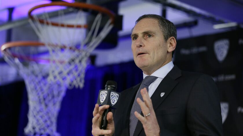 Pac-12 Commissioner Larry Scott speaks during the Pac-12 NCAA college basketball media day Thursday, Oct. 11, 2018, in San Francisco.
