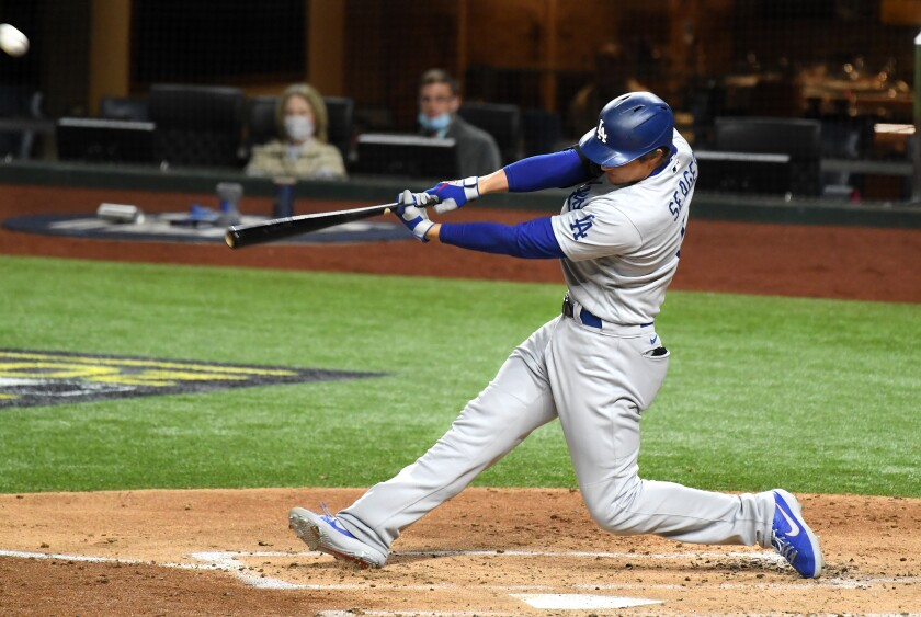 Dodgers shortstop Corey Seager hits a solo home run against the Tampa Bay Rays.
