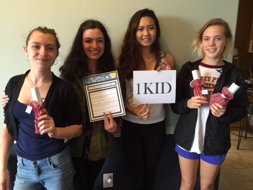 The 1Kid organization brings art kits and classes to children in need. Taylor Austin, Tori Austin, 1Kid founder Micaela Roy and Sam Parkes led a recent arts and crafts workshop at the Ronald McDonald House.