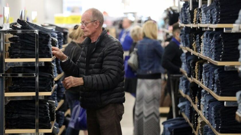 Customers browse apparel Oct. 4, 2018, at the recently reopened Sears store in Oakbrook Center.