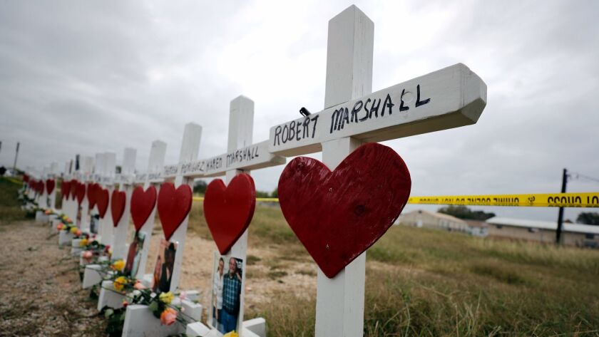 Crosses showing shooting victims' names stand near the First Baptist Church in Sutherland Springs, Texas, on Nov. 9.