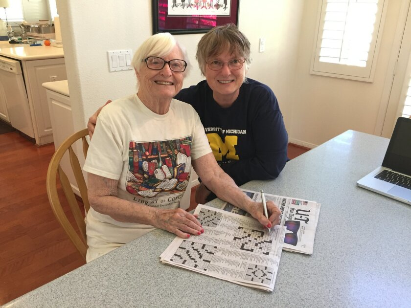 Claire Boiko, 89, and her daughter Susan Boiko, with the morning New York Times crossword puzzle at Susan's home in Carlsbad last week.