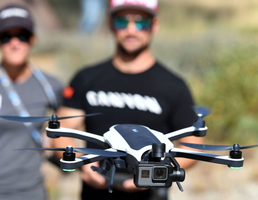 Darren Berreclota, right, pilots a GoPro Karma drone during a media event in Olympic Valley, California on Sept. 19.