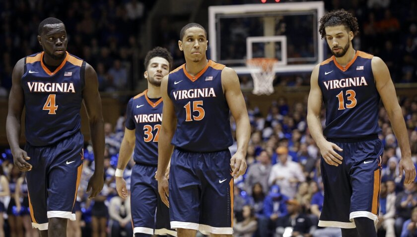 Virginia's Marial Shayok (4), London Perrantes (32), Malcolm Brogdon (15) and Anthony Gill (13) walk up court late in second half of an NCAA college basketball game against Duke in Durham, N.C., Saturday, Feb. 13, 2016. Duke won 63-62. (AP Photo/Gerry Broome)