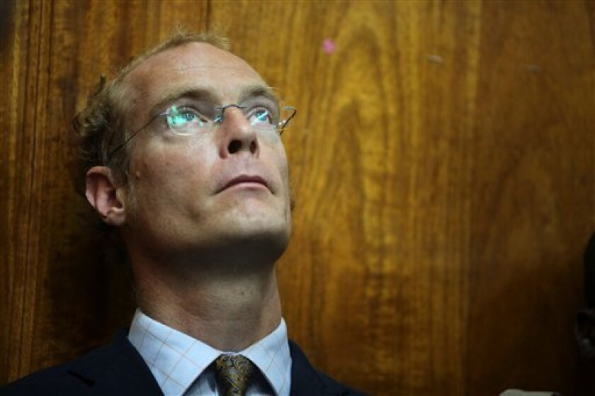 Thomas Cholmondeley stands in the dock Tuesday, May 12, 2009 in the Nairobi high court, Kenya, where sentencing on manslaughter charges was postponed until Thursday. His sentence could range from the maximum of life imprisonment to counting the three years he has already served and letting him walk. Cholmondely was convicted of manslaughter Thursday in the shooting of a black poacher, a case that underlined sharp divisions over land, race and privilege in the African country. (AP Photo/Karel Prinsloo)
