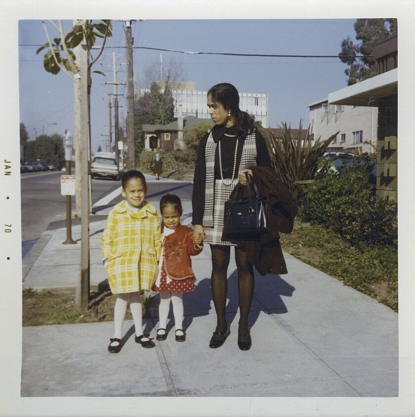 This January 1970 photo provided by the Kamala Harris campaign shows her, left, with her sister, May