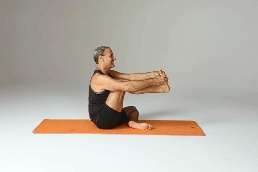 Sit cross-legged on a padded surface or a mat. Bring your right knee toward your chest and hold the sole of your right foot with both hands. Inhale, sit up tall and move your knee toward your chest without rounding your back or collapsing forward. Pause for a few breaths while feeling a stretch in the back of your right thigh.