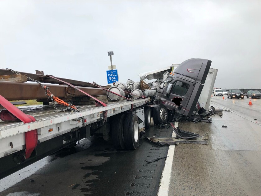 Beer spilled on south Interstate 5 near Las Pulgas Road when a big rig crashed into the back of another truck. A pedestrian was killed on the freeway earlier in the morning.