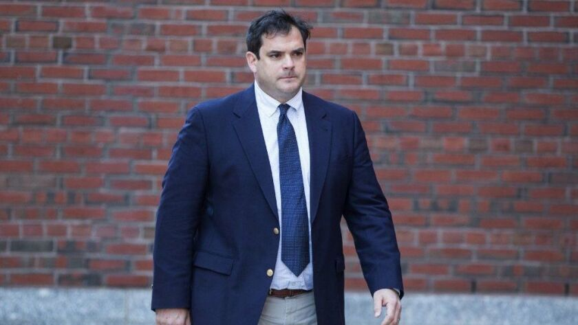 Former Stanford sailing coach John Vandemoer arrives at federal court in Boston for an arraignment on March 12.