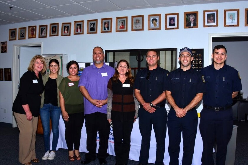 Stacy Rungaitis, executive director of the Palomar College Foundation, with Assistance League Inland North County scholarship recipients Alejandra Cuevas, Adriana Vazquez, Clinton Swanger, Palomar College Development Officer Kim Hartwell, scholarship recipients Ricky Whitlock, Adrian Del Castillo and Jonathan Davis.