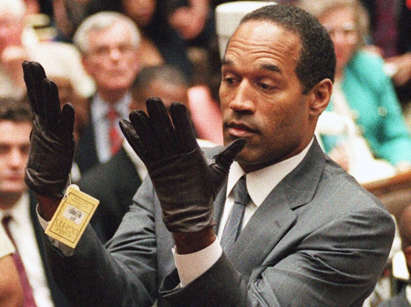 Showing gloved hands to the jury