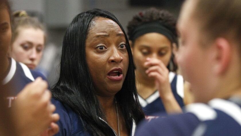 Christian coach Vickie Carrington (shown at an earlier game) guided the Patriots to an upset win over Cathedral Catholic on Friday.