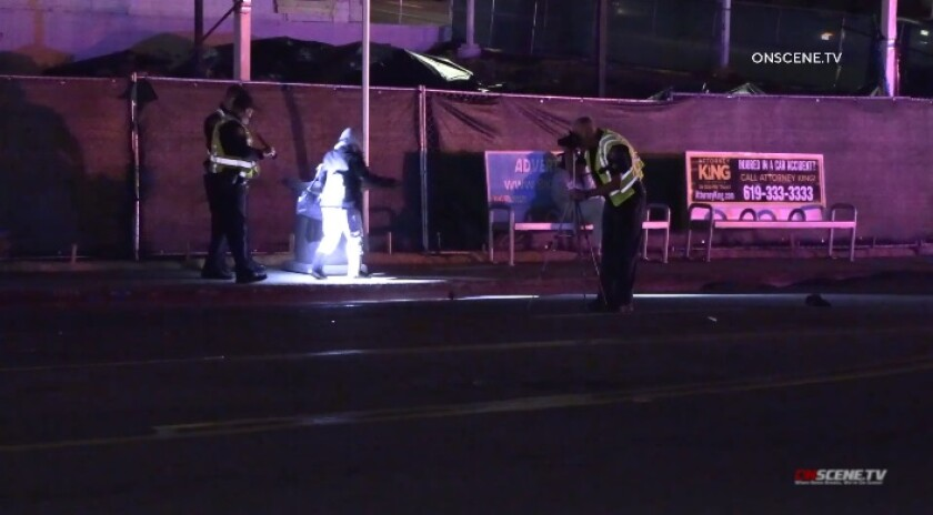 A traffic investigator takes a measurement Friday night at the scene of a fatal pedestrian crash in Grantville.