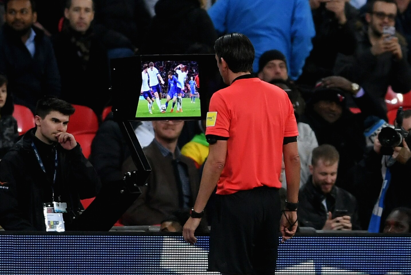 LONDON, ENGLAND - MARCH 27: Referee Deniz Aytekin checks the VAR during the International friendly between England and Italy at Wembley Stadium on March 27, 2018 in London, England.