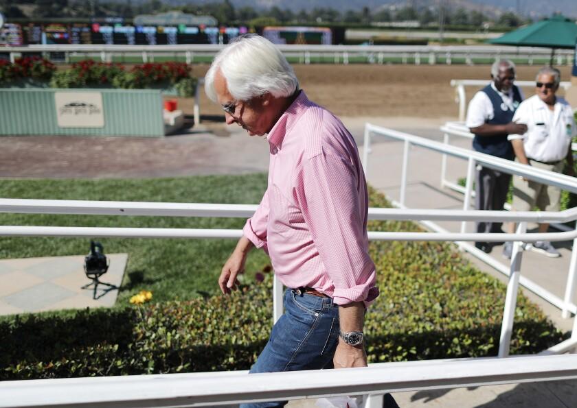 Trainer Bob Baffert departs the winner's circle at Santa Anita Park on June 2019.