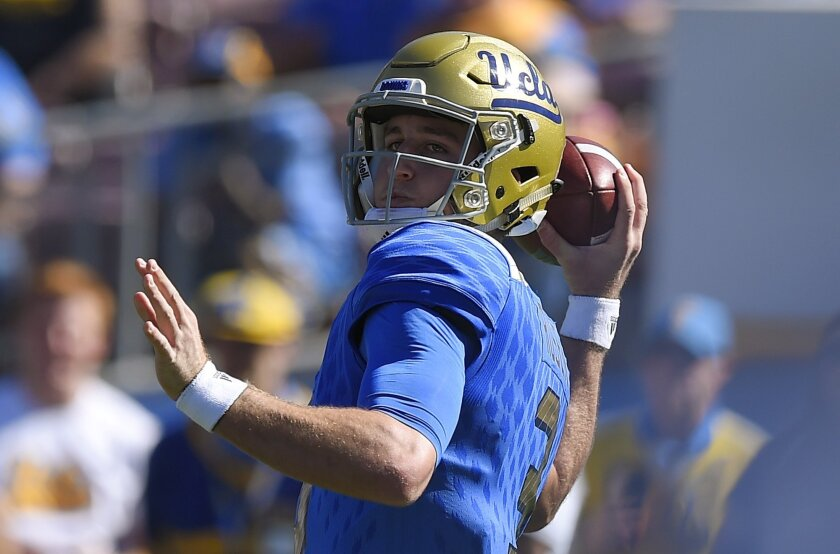 FILE - In this Oct. 31, 2015, file photo, UCLA quarterback Josh Rosen passes during the first half of an NCAA college football game against Colorado, in Pasadena, Calif. Rosen is considered among the top freshman in the country at his position. (AP Photo/Mark J. Terrill, File)