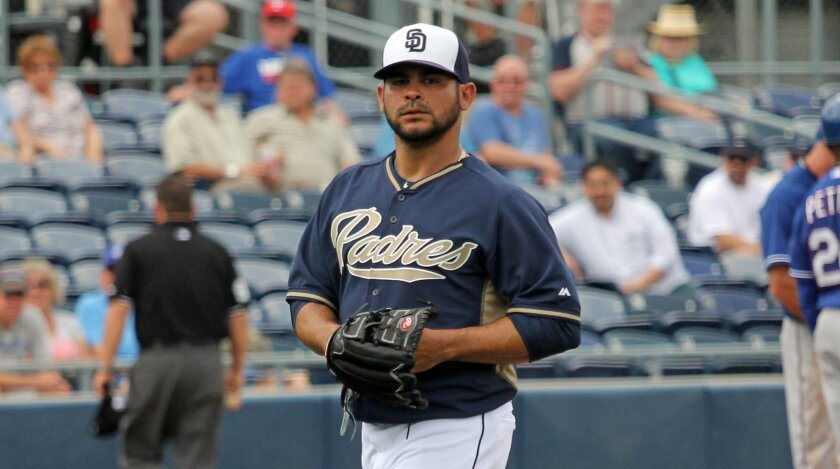 Padres pitcher Alex Torres walks off the field after being taken out against the Rangers during their spring training game in Peoria, Ariz.