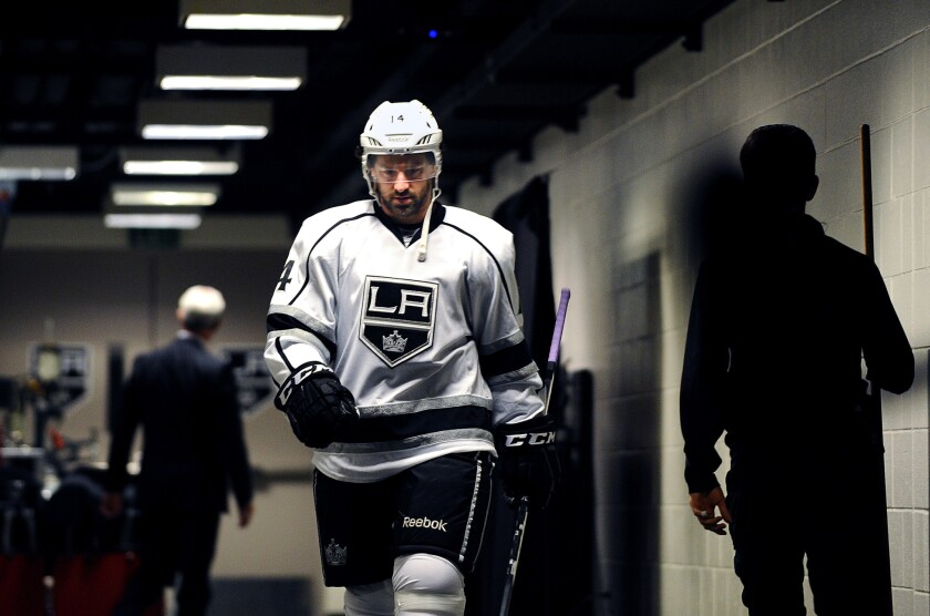 Justin Williams walks out of the Kings locker room before taking the ice for a 2014 playoff game.