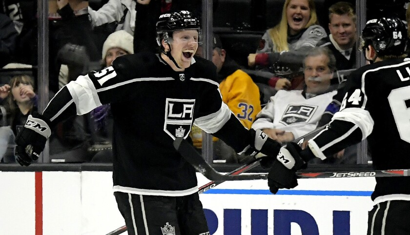 Kings left wing Austin Wagner, left, celebrates his first NHL goal with right wing Matt Luff during the third period of a a game against the Avalance on Nov. 21.