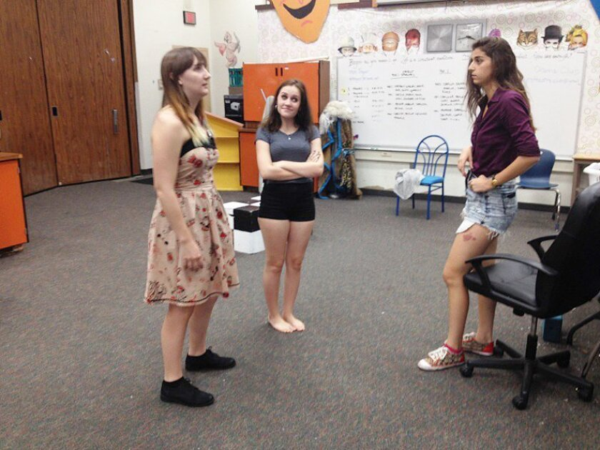 Junior Alissa Hebert and senior Melanie Moore take direction from senior Melisa Conroy, co-director of La Jolla High's first production under the auspices of drama director, Marjorie Treger.