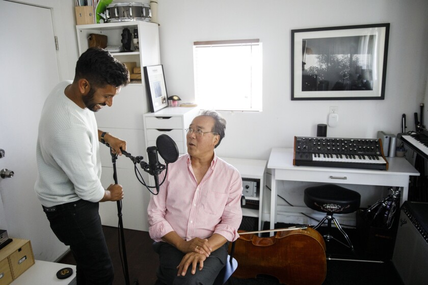 Hrishikesh Hirway, founder of the Song Exploder podcast, prepares to interview cellist Yo-Yo Ma in H
