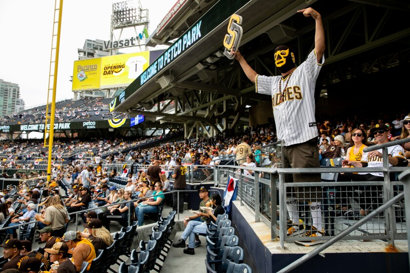 """It will cost more in 2022 for fans such as Mercury Hornbeek, who goes by """"Padre Libre,"""" to watch Padres play at Petco Park."""