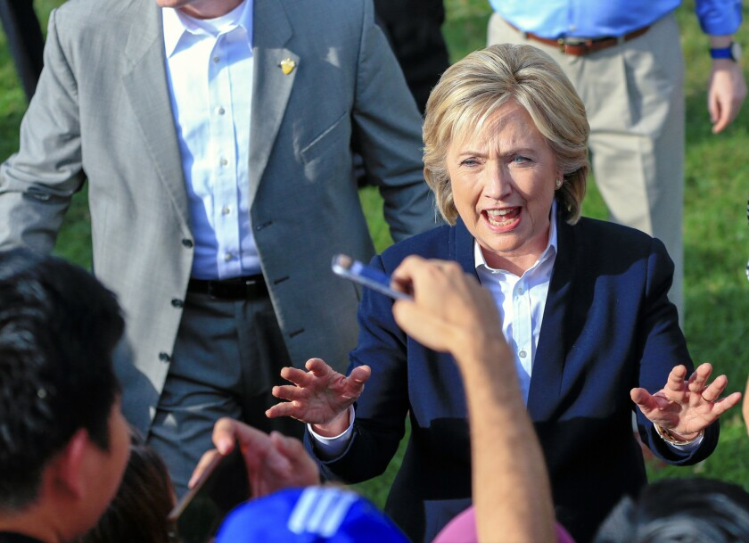 Democratic presidential candidate Hillary Rodham Clinton speaks with supporters on Oct. 7 after a campaign stop at the Westfair Amphitheater in Council Bluffs, Iowa.