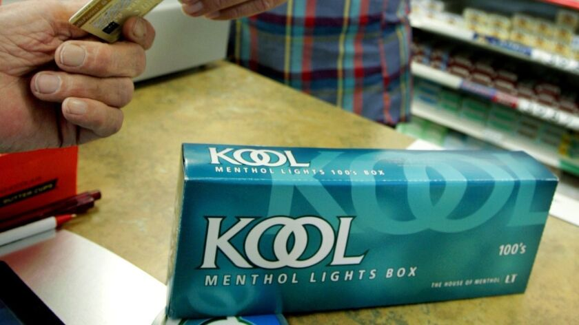 A customer buys a carton of menthol cigarettes at a store in Minneapolis in 2005.