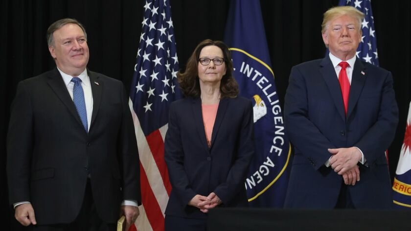 From left, Secretary of State Michael R. Pompeo, Gina Haspel and President Trump attend the swearing-in ceremony for Haspel as CIA director at agency headquarters on May 21, 2018, in Langley, Va.