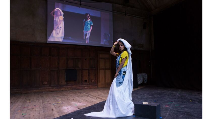 London-based actress Yoko Ishiguro is shadowed by Gazan dancer Walid Tafesh during a performance of