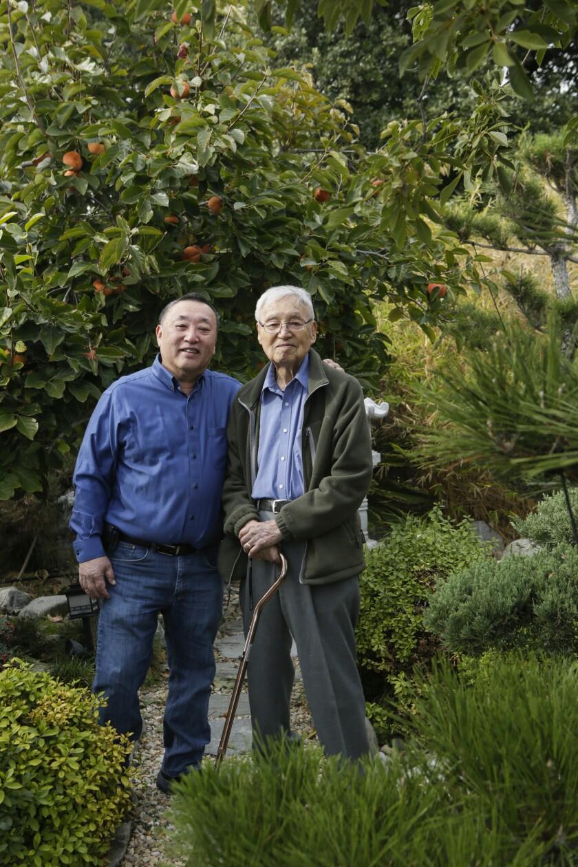 John Nishio, 71, left, and Shig Nishio, 98