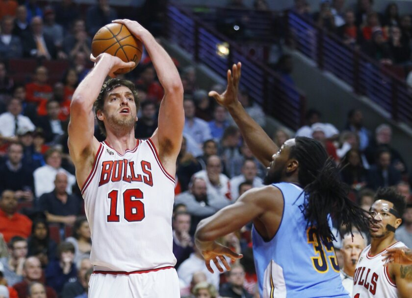 FILE -  In this Dec. 2, 2015, file photo, Chicago Bulls center Pau Gasol (16) shoots over Denver Nuggets forward Kenneth Faried (35) during the second half of an NBA basketball game, in Chicago. The Bulls All-Star is one of the most skilled big men in the league. But the 35-year-old also can become