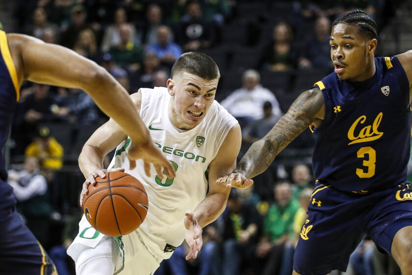 Oregon guard Payton Pritchard drvies to the basket against California during a game March 5, 2020, in Eugene, Ore.