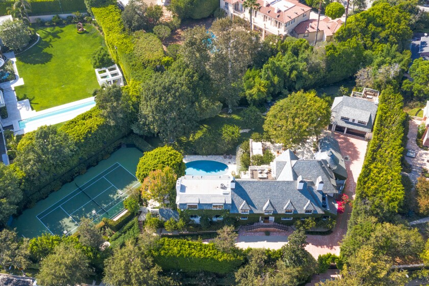 The ivy-draped traditional spans 10,400 square feet with five bedrooms and nine bathrooms.
