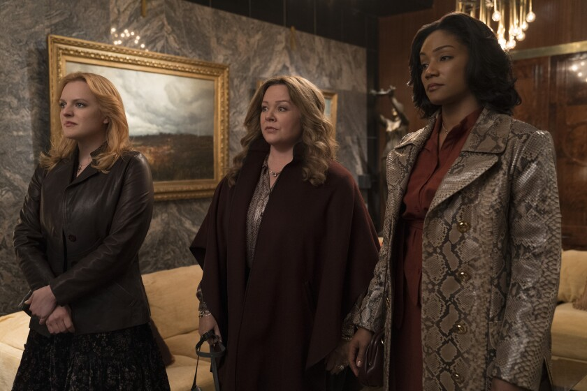 "Elisabeth Moss, left, Melissa McCarthy and Tiffany Haddish in the movie ""The Kitchen."""
