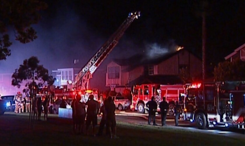 A fire at a Mira Mesa home early Wednesday displaced six people and caused almost $500,000 in damage.