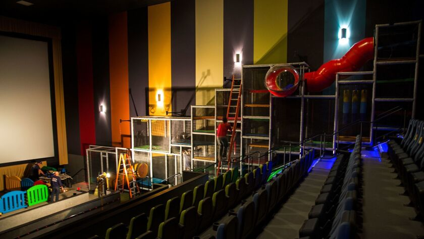 Construction workers finish a play structure inside the children's auditorium at Cinepolis USA's Pico Rivera multiplex.