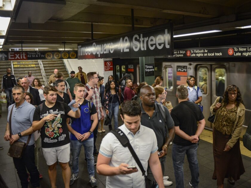 Straphangers wait at the crowded 42th St. subway station after 1, 2, 3, 4, and 5 train delays in September 2017.