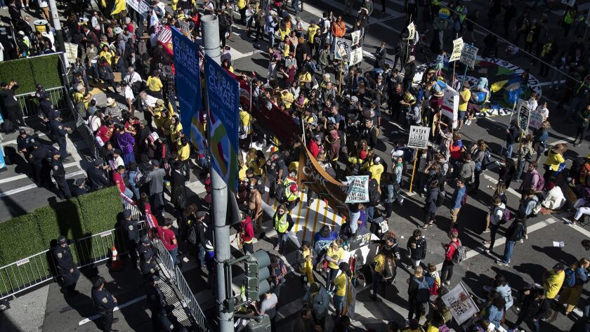 SAN FRANCISCO, CA - SEPTEMBER 13, 2018: Hundreds of protesters push their way towards the Moscone Ce