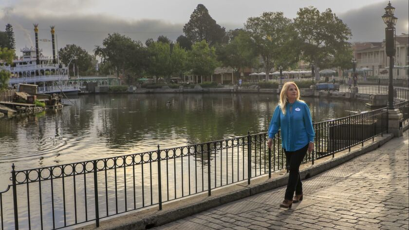 Kim Irvine is arguably the person most responsible for maintaining the look and feel of Disneyland. Irvine takes an early morning stroll through New Orleans Square, next to the Rivers of America before the park opens on April 25.