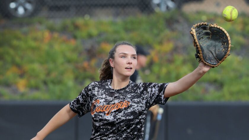 Escondido High's Rylee Penrod catches the ball while on first base during practice.