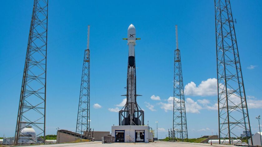 A SpaceX rocket is loaded with satellites on May 16 ahead of a launch at Cape Canaveral in Florida.