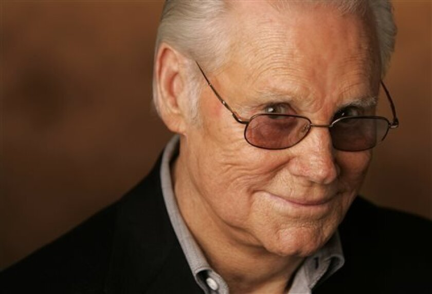 """FILE - In this Jan. 10, 2007 file photo, George Jones is shown in Nashville, Tenn.  Jones, the peerless, hard-living country singer who recorded dozens of hits about good times and regrets and peaked with the heartbreaking classic """"He Stopped Loving Her Today,"""" has died. He was 81. Jones died Frida"""