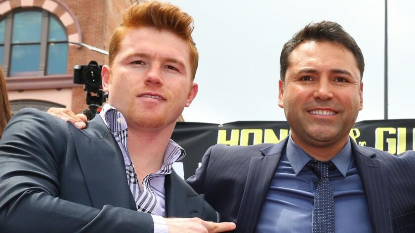 Saul 'Canelo' Alvarez, left, and Golden Boy Promotions President Oscar De La Hoya.